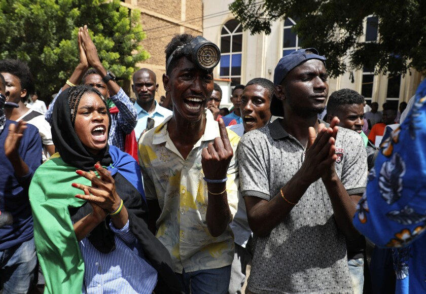 Sudanese protesters gather outside the Cabinet's headquarters in the capital, Khartoum, Sudan, Monday, Aug. 17, 2020. The protesters returned to the streets Monday to pressure transitional authorities for more reforms, a year after a power-sharing deal between the pro-democracy movement and the generals. (AP Photo/Marwan Ali)