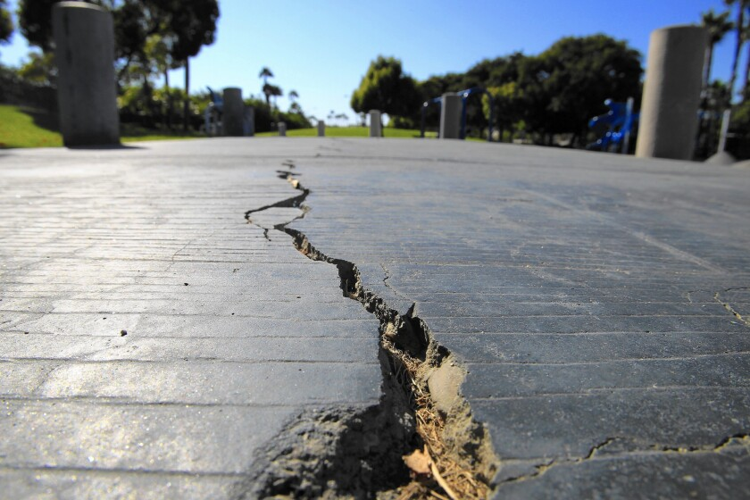 A long crack splits the sidewalk at Discovery Well Park in Huntington Beach, which is located on top of the Newport-Inglewood fault.