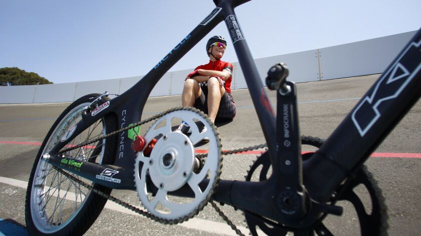 Denise Mueller-Korenek takes a training break at the San Diego Velodrome behind the bike she'll race on for the world paced bicycle speed record.