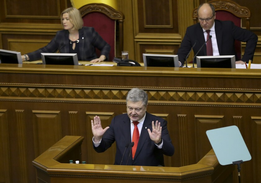 Ukrainian President Petro Poroshenko gestures during a parliament session in Kiev, Ukraine, Monday,
