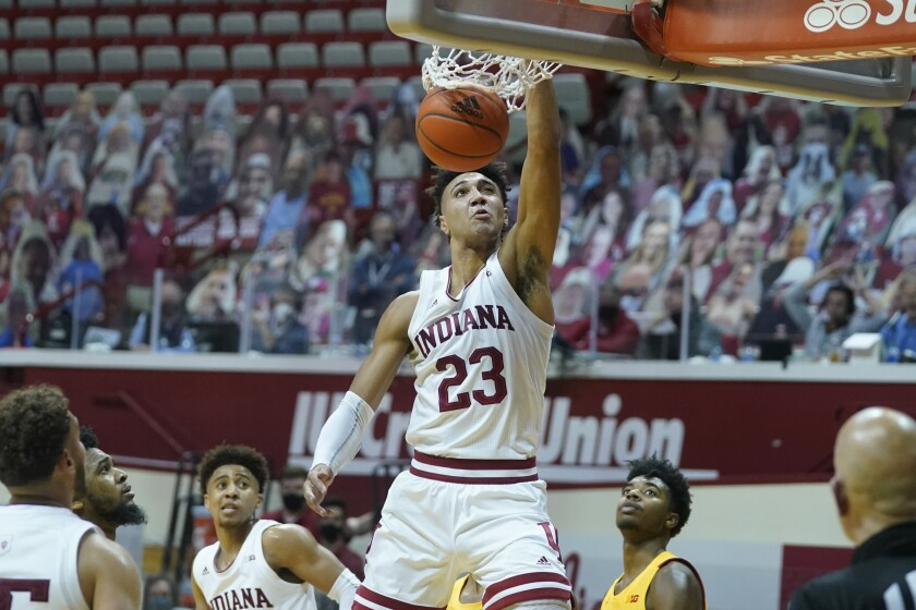 Indiana forward Trayce Jackson-Davis (23) dunks during the second half of an NCAA college basketball game against Maryland, Monday, Jan. 4, 2021, in Bloomington, Ind. (AP Photo/Darron Cummings)
