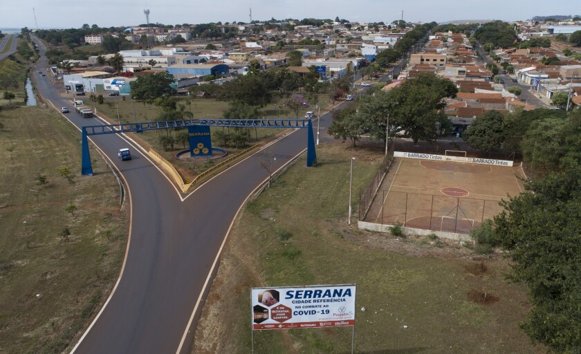 An aerial view of the entrance of Serrana, Sao Paulo state, Brazil, Friday, May 28, 2021. Brazil's Butantan Institute has finished a mass vaccination of the city's entire adult population with doses of Sinovac, to test the new coronavirus' behavior in response to the vaccine. (AP Photo/Andre Penner)