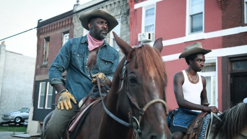 "Idris Elba, left, and Caleb McLaughlin in Ricky Staub's ""Concrete Cowboy"""