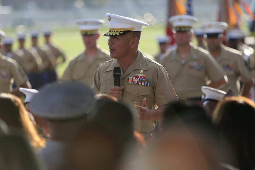 Brigadier General Daniel Yoo addresses fellow Marines and other attendees following the change of command ceremony at Camp Pendleton Thursday evening.