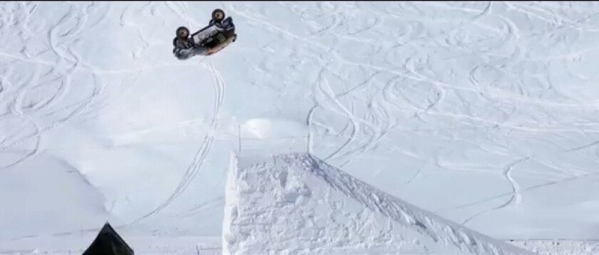 Guerlain Chicherit back-flips a Mini at a winter sports resort in Tignes, France.