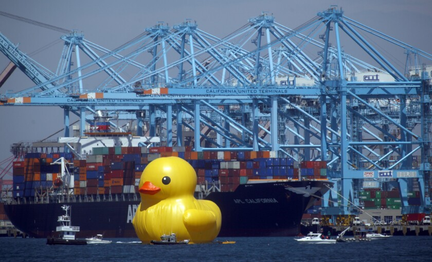 A giant rubber duck passes through the Port of Los Angeles as part of the Festival of Tall Ships.