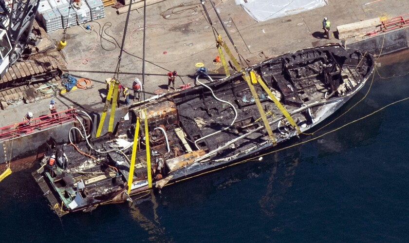 FILE - In this Sept. 12, 2019, file photo, the burned hull of the dive boat Conception is brought to the surface by a salvage team off Santa Cruz Island, Calif. Federal investigators who examined the burned-out wreckage of a scuba diving boat have not been able to determine what ignited a fire that killed 34 people off the California coast, a law enforcement official said Friday, Sept. 27. (Brian van der Brug/Los Angeles Times via AP, File)