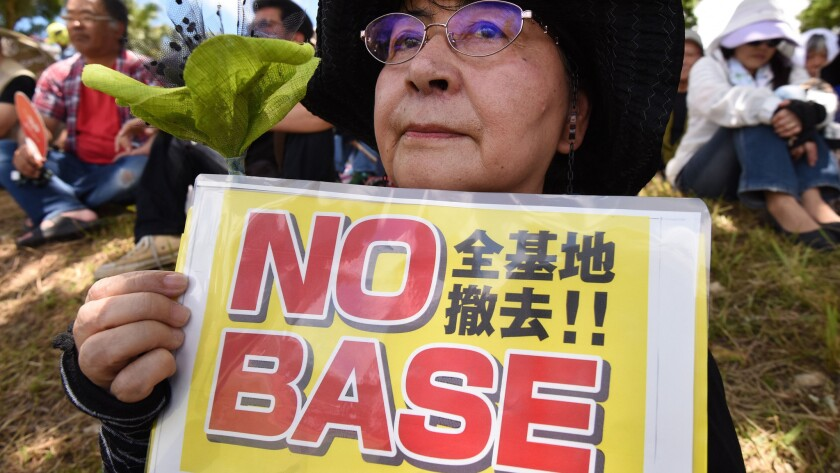 A demonstrator takes part in a rally against the U.S. military presence in Naha in Japan's Okinawa prefecture on June 19, 2016.