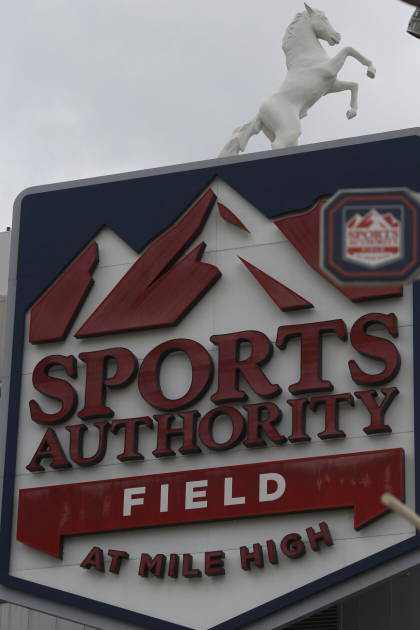 In this Thursday, May 26, 2016, photograph, the sign for Sports Authority Field at Mile High is shown on the south end of the stadium that is the home of the NFL football Denver Broncos in Denver. With the demise of Sports Authority, which holds the naming rights to the stadium, a fight over what t