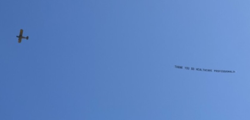 A plane towing a banner flies over Scripps Green Hospital in La Jolla on April 24 with a message of thanks for health care workers.