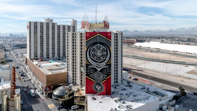 "With a message of peace on the planet, ""Cultivate Harmony"" is a mural spanning 21 floors of the Plaza's north-facing wall along Main Street. Artist Shepard Fairey designed it, a team of painters from JustKids made it happen."