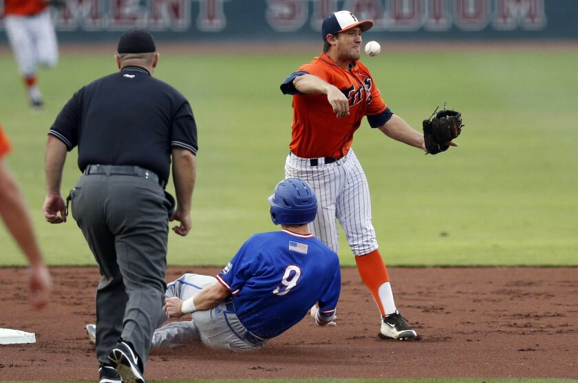 Louisiana Tech's Chase Lunceford (9) slides into a double play as Cal State Fullerton infielder Timmy Richards (13) throws to first during the second inning their NCAA college regional baseball tournament game at Dudy Noble Field in Starkville, Miss., Friday, June 3, 2016. The game was held up in t