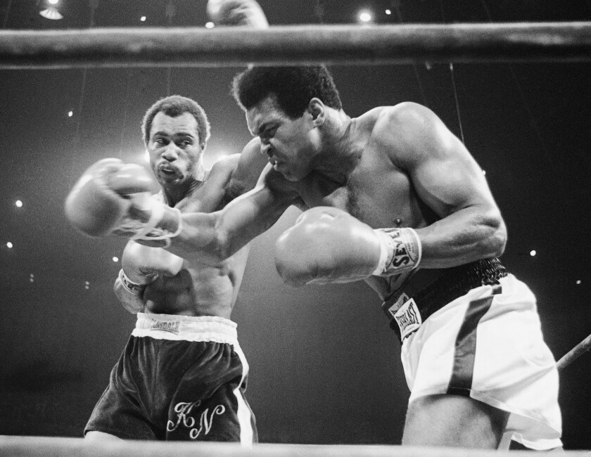 FILE - In this Sept. 10, 1973, file photo, Muhammad Ali, right, winces as Ken Norton hits him with a left to the head during their re-match at the Forum in Inglewood. Norton, a former heavyweight champion, has died. He was 70.