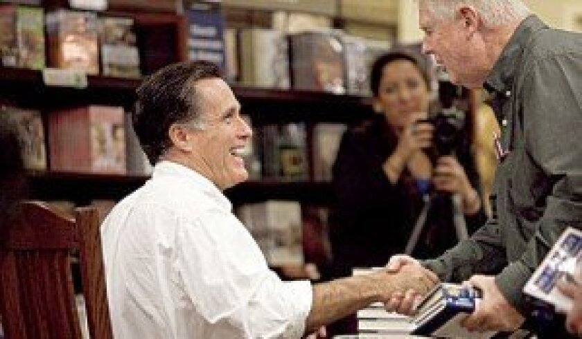 Mitt Romney greets people during a book-signing in La Jolla in 2010. Light File Photo