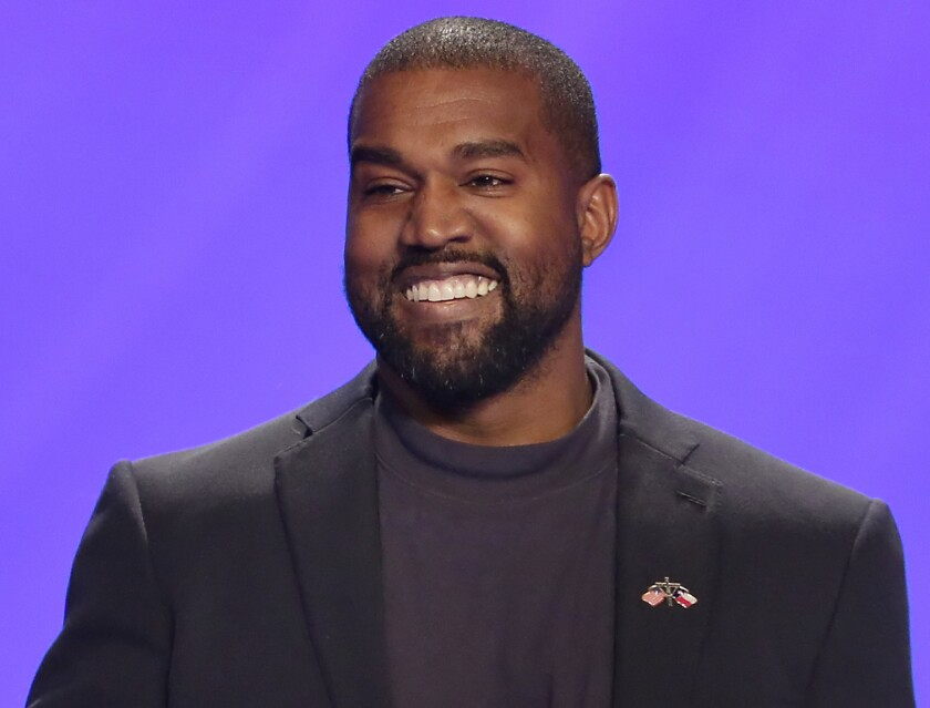FILE - This Nov. 17, 2019 file photo shows Kanye West on stage during a service at Lakewood Church in Houston. West has donated $2 million dollars to support the families and legal teams for George Floyd, Ahmaud Arbery and Breonna Taylor. A representative for the rapper confirmed that some of the money donated would fully cover college tuition costs for Floyd's 6-year-old daughter, Gianna. Floyd died last month after a Minneapolis police officer pressed his knee on his neck for more than eight minutes as he pleaded for air. (AP Photo/Michael Wyke, File)