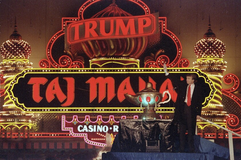 Donald Trump celebrates the grand opening of the Taj Mahal in 1990. The Atlantic City casino was in financial trouble later that year.