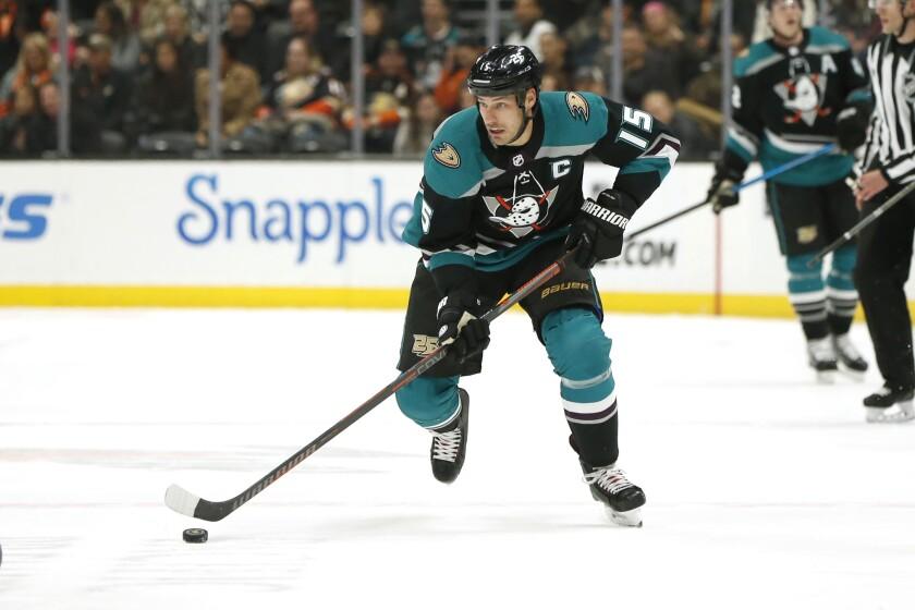 Ducks captain Ryan Getzlaf controls the puck during a game last season.