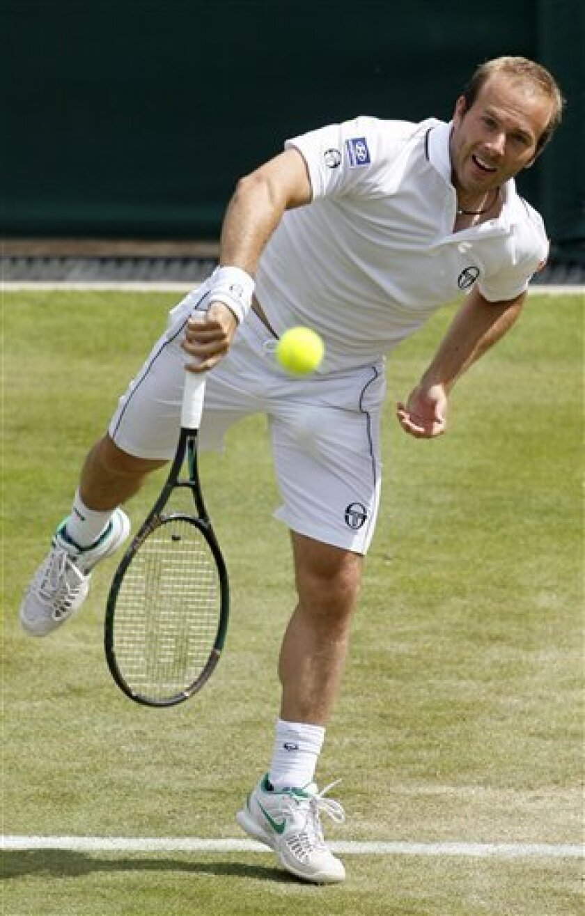 Belgium's Olivier Rochus in action during the match against Argentina's Juan Martin Del Potro at the All England Lawn Tennis Championships at Wimbledon, Thursday, June 23, 2011.(AP Photo/Alastair Grant)
