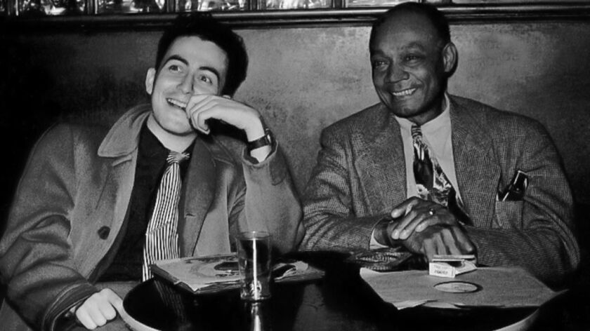 """Nat Hentoff and clarinetist Edmond Hall are shown at the Savoy club in Boston in November 1948 in a scene from the movie """"The Pleasures of Being Out of Step."""""""