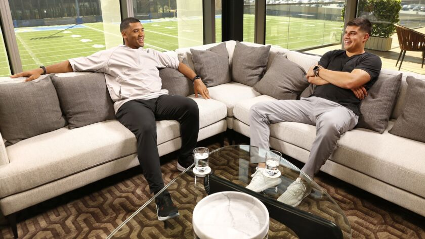 LOS ANGELES, CA – MARCH 29, 2018: Seattle Seahawks Quarterback Russell Wilson, left, talks with Ma