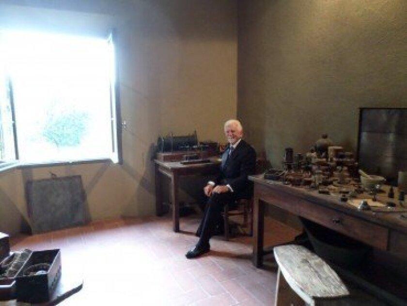 Martin Cooper sitting at Guglielmo Marconi's desk. Courtesy photo