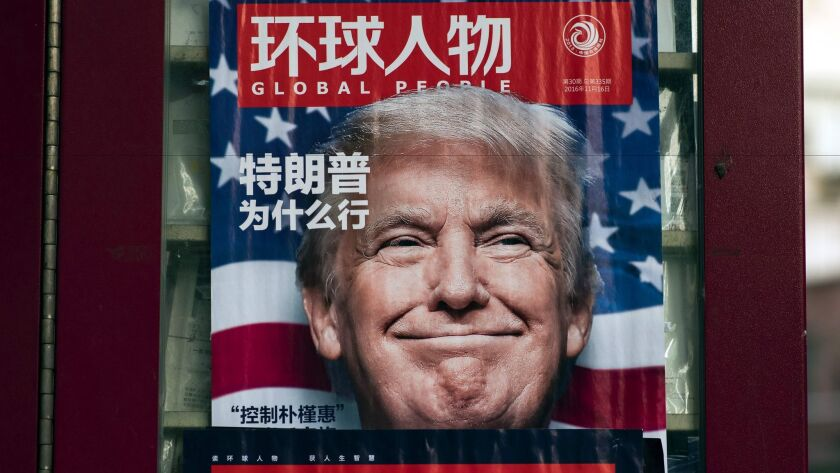 A newsstand in Shanghai, China, bears an ad for a magazine featuring Donald Trump on the cover.