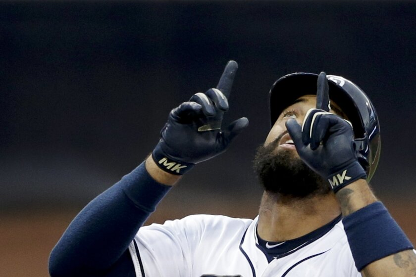 The Padres' Matt Kemp points skyward after hitting a home run against the Colorado Rockies during the first inning of a baseball game Wednesday, Sept. 9, 2015, in San Diego.