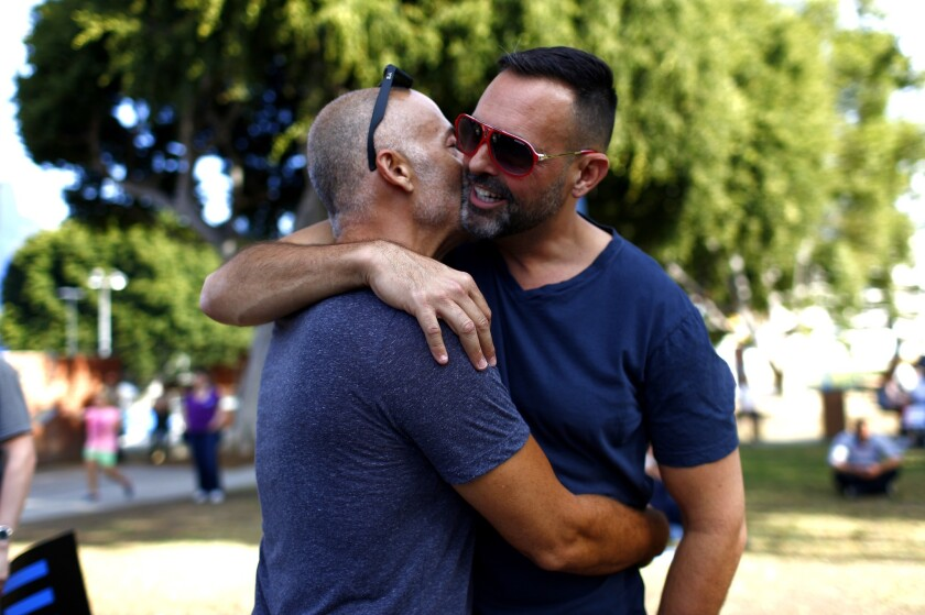 Two men embracing