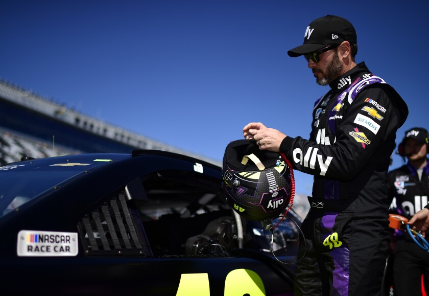 Jimmie Johnson stands on the grid during qualifying for the Daytona 500 on Feb. 9.