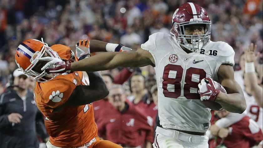 Alabama's O.J. Howard races past Clemson's T.J. Green during the 2016 national championship game in Glendale, Ariz. When the teams meet Monday, it will be their fourth playoff meeting in four seasons.