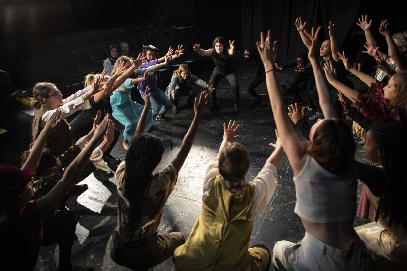 LOS ANGELES, CA - MARCH 23, 2019: A young Shakespeare troupe warms-up on stage before their performa