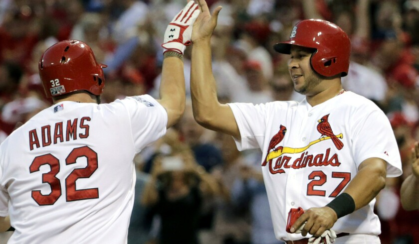 Although shortstop Jhonny Peralta (27) was a key free-agent acquisition this season, first baseman Matt Adams and others in the starting lineup are Cardinals prospects who have helped make up for the loss of slugger Albert Pujols.