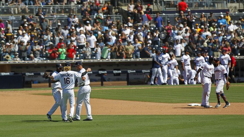 The Padres celebrate a June 6 victory over the Atlanta Braves.