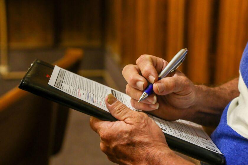 Francisco Jimenez, 60, registers to vote.