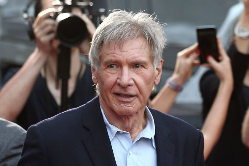 FILE - In this December 10, 2015 file photo, Harrison Ford greets fans during a Star Wars fan event