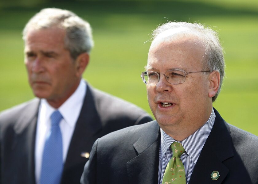 Master of social welfare: Karl Rove (R), seen here with his protege President George W. Bush in 2007. Rove's political campaign group recently earned a tax exemption from the IRS.
