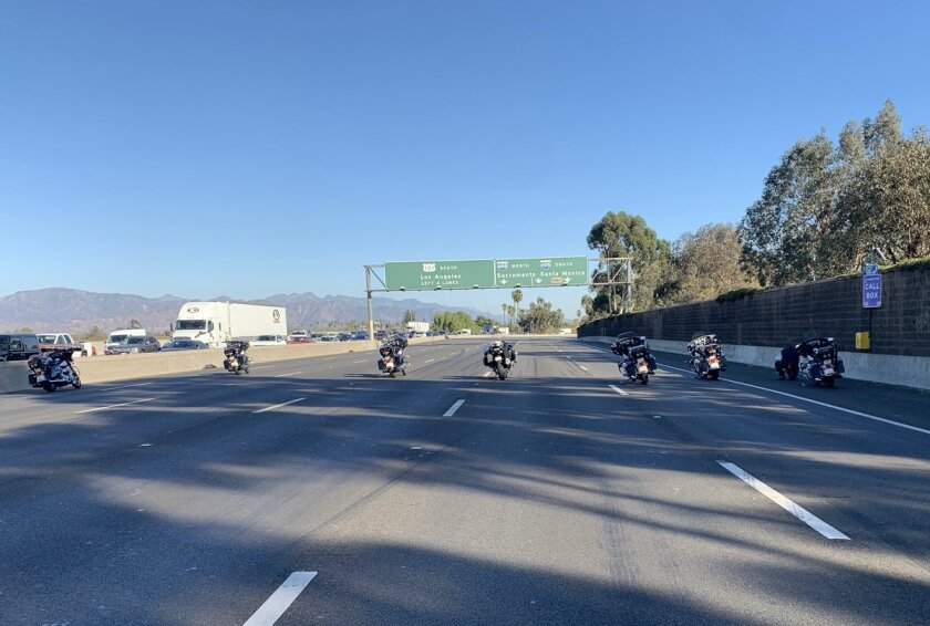 Police motorcycles parked on a shut-down freeway