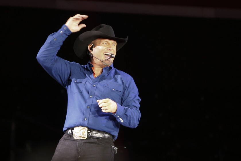 Garth Brooks performs in New York on July 8. On Wednesday, a week after launching its new paid streaming music service, Amazon announced a deal with Brooks.