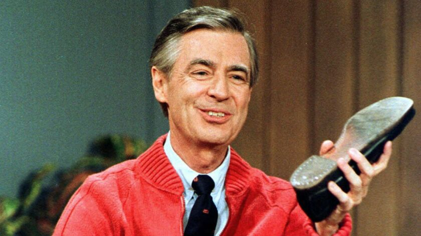 """FILE - In this June 28, 1989, file photo, Fred Rogers rehearses for the opening of his PBS show """"Mis"""