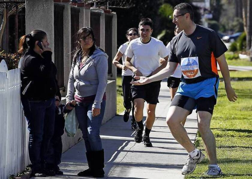 Los Angeles mayoral candidate Emanuel Pleitez greets pedestrians in the San Fernando Valley on one of his 20-mile runs to drum up votes.