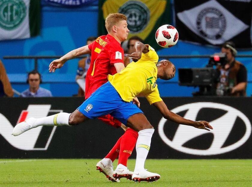 Belgium's Kevin De Bruyne (L) in action against Brazil's Fernandinho (R) during the 2018 FIFA World Cup quarterfinal match between Brazil and Belgium in Kazan, Russia, on July 6, 2018. EPA-EFE FILE/ROBERT GHEMENT