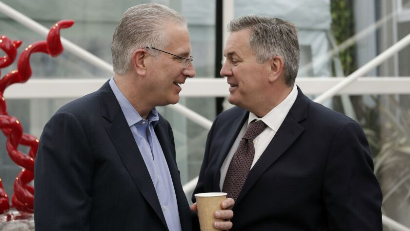 Tod Leiweke, left, chats with his brother, Tim, following a 2018 news conference naming Tod as president and CEO of the NHL expansion team in Seattle.