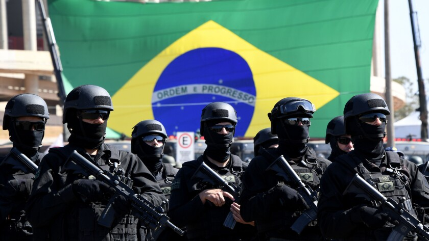 Brazilian army special forces participate in a ceremony showcasing security forces to be deployed during the Rio Olympics.