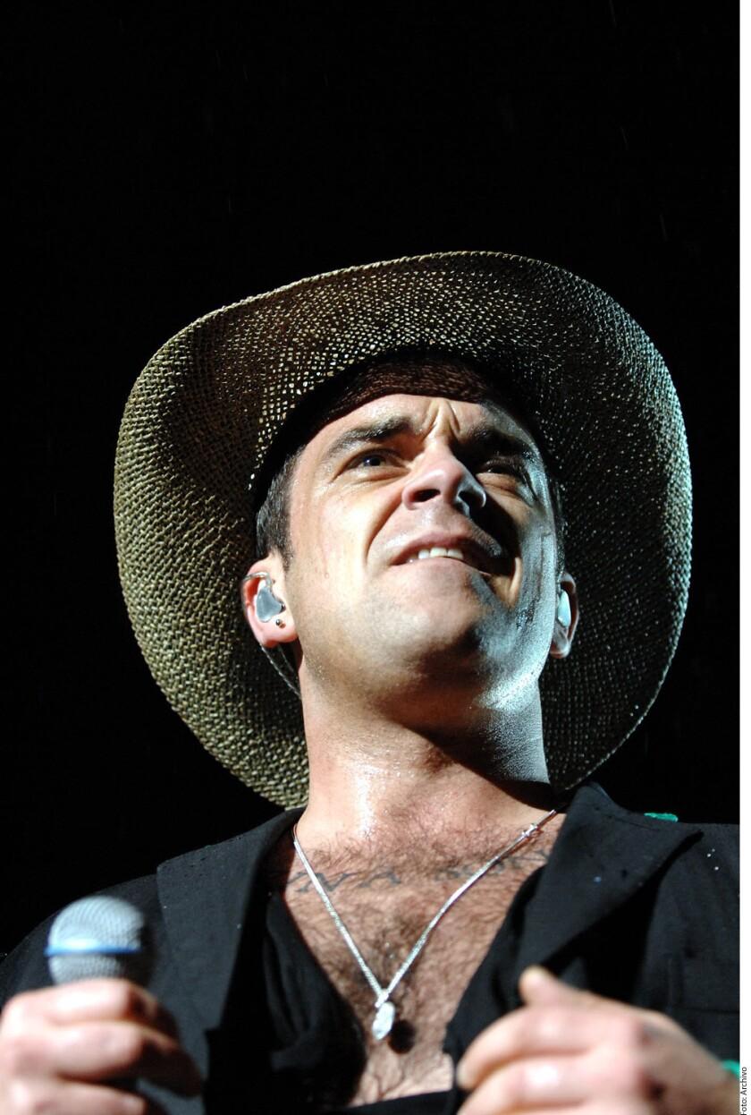 Robbie Williams confesó que pasó una semana en cuidados intensivos este año debido a anormalidades en su cerebro.