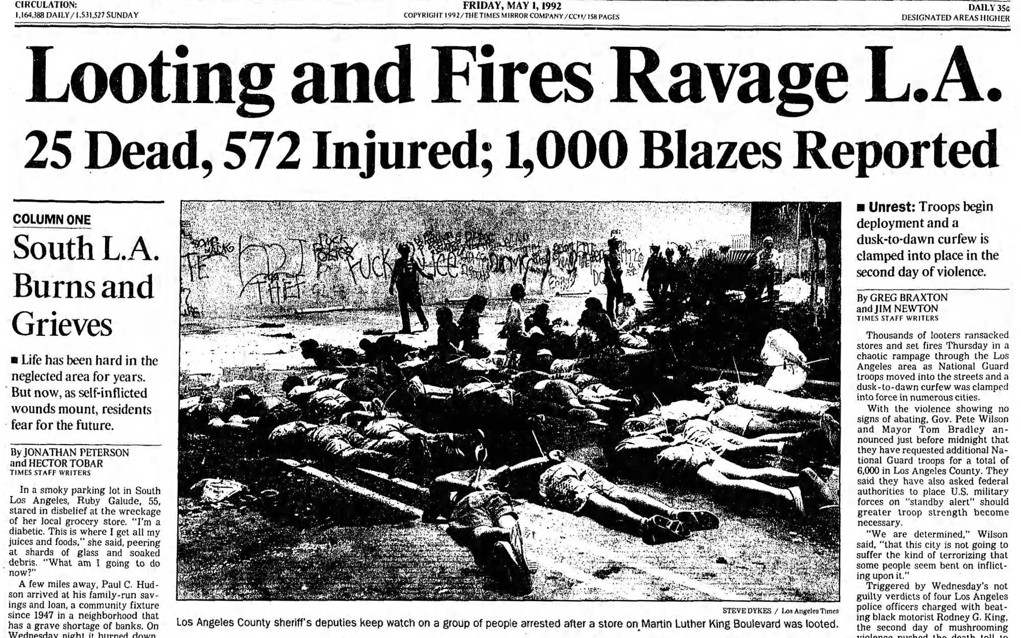 """1992 LA Times front page headline reads """"Looting and fires ravage LA. 25 dead, 572 injured; 1,000 blazes reported"""""""