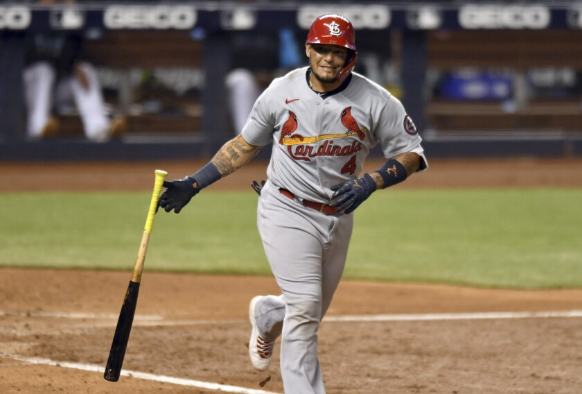 St. Louis Cardinals' Yadier Molina drops his bat after hitting a sacrifice fly during the sixth inning of the team's baseball game against the Miami Marlins, Tuesday, April 6, 2021, in Miami. (AP Photo/Jim Rassol)