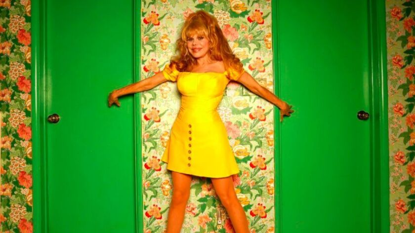 Charo fits right in with the decor in her home.