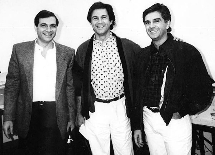 Armand, left, Georges and Maurice Marciano, circa 1988. The three brothers started Guess Inc. with brother Paul in Los Angeles in 1981.