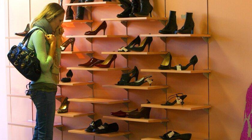 U-T FILE: In this Jan. 26, 2012 file photo, Laura Grannis of Del Mar looks over the shoe display at My Sister's Closet in La Jolla.