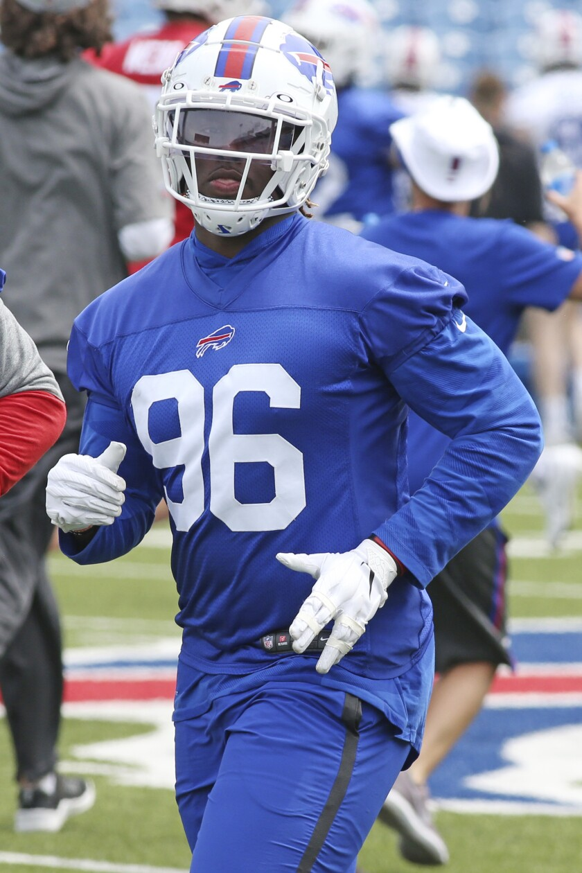 FILE - Buffalo Bills defensive lineman Carlos Basham (96) is shown during the NFL football team's organized team activities in Orchard Park, N.Y., in this Wednesday June 2, 2021, file photo. Bills Safety Micah Hyde recalled being immediately impressed with general manager Brandon Beane for going big -- in numbers and size -- to address Buffalo's defensive-line needs during the NFL draft. Using Buffalo's top two picks to select 6-foot-6, 266-pound Greg Rousseau and 6-3, 281-pound Carlos Basham not only adds bulk up front, the benefits should filter back to the secondary. (AP Photo/Jeffrey T. Barnes, File)